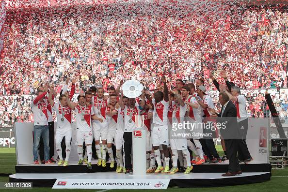 Team captain Miso Brecko of Cologne lifts the trophy after winning the championship title of the Second Bundesliga at RheinEnergieStadion on May 4...