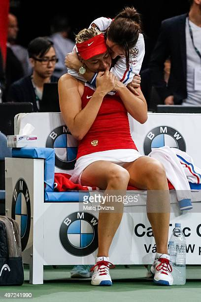 Team captain of Russia Anastasia Myskina embraces Maria Sharapova of Russia after winnig against Petra Kvitova of Czech Republic during day two of...