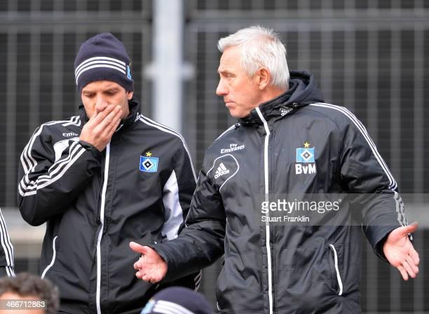 Team captain Rafael van der Vaart talks with Bert van Marwijk head coach of Hamburg during the training session of Hamburger SV on February 3 2014 in...