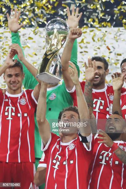 Team captain Thomas Mueller celebrates with the trophy after his team won the DFL Supercup 2017 match between Borussia Dortmund and Bayern Muenchen...