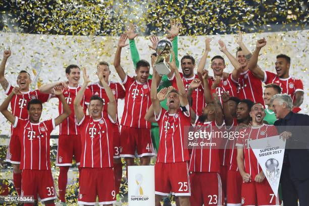 Team captain Thomas Mueller lifts the trophy after his team won the DFL Supercup 2017 match between Borussia Dortmund and Bayern Muenchen at Signal...
