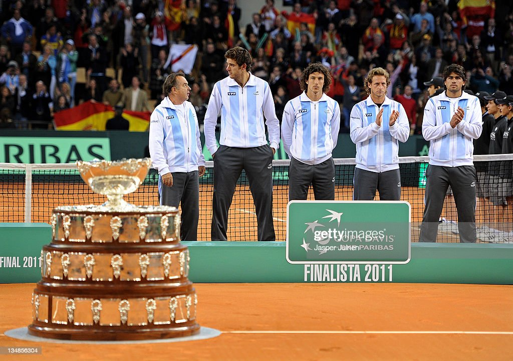 Team captain Tito Vazquez (L) of Argentina chats with Juan Martin del Potro (2nd L) as they stand with Juan Monaco (C), David Nalbandian (2nd R) and Eduardo Schwank (R) besides the Davis Cup trophy during the third and last day of the final Davis Cup match between Spain and Argentina on December 4, 2011 in Seville, Spain.