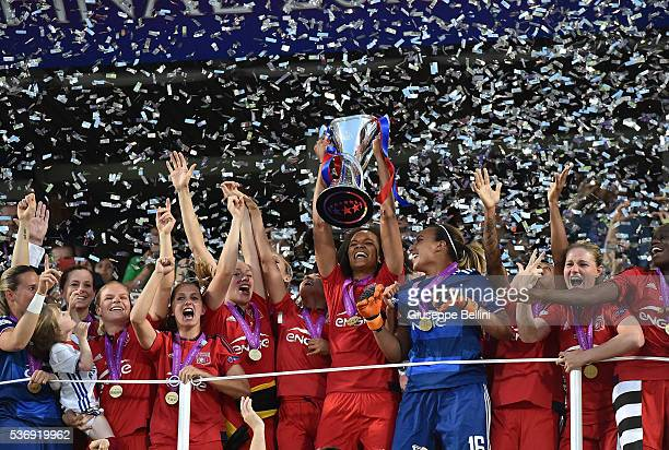 Team captain Wendie Renard of Olympique Lyonnais lifts the winners trophy after UEFA Women's Champions League Final between VfL Wolfsburg v Olympique...