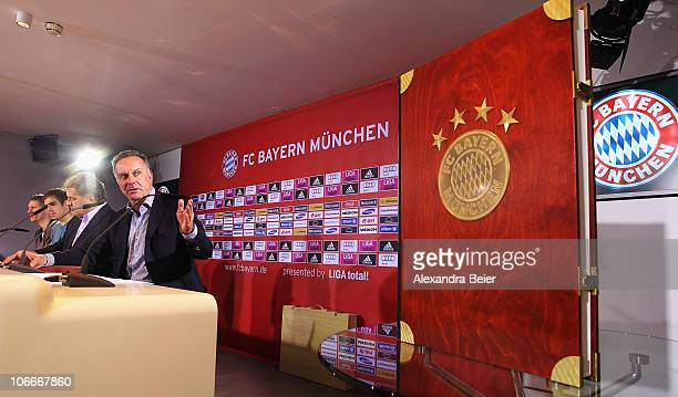 Team captains Bastian Schweinsteiger and Philipp Lahm and CEO of Bayern Muenchen KarlHeinz Rummenigge present the chronicle of FC Bayern Muenchen on...