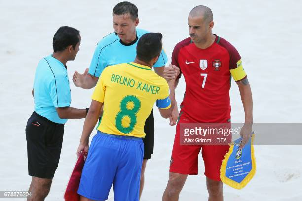 Team captains Bruno Xavier of Brazil and Madjer of Portugal shake hands prior to the FIFA Beach Soccer World Cup Bahamas 2017 quarter final match...