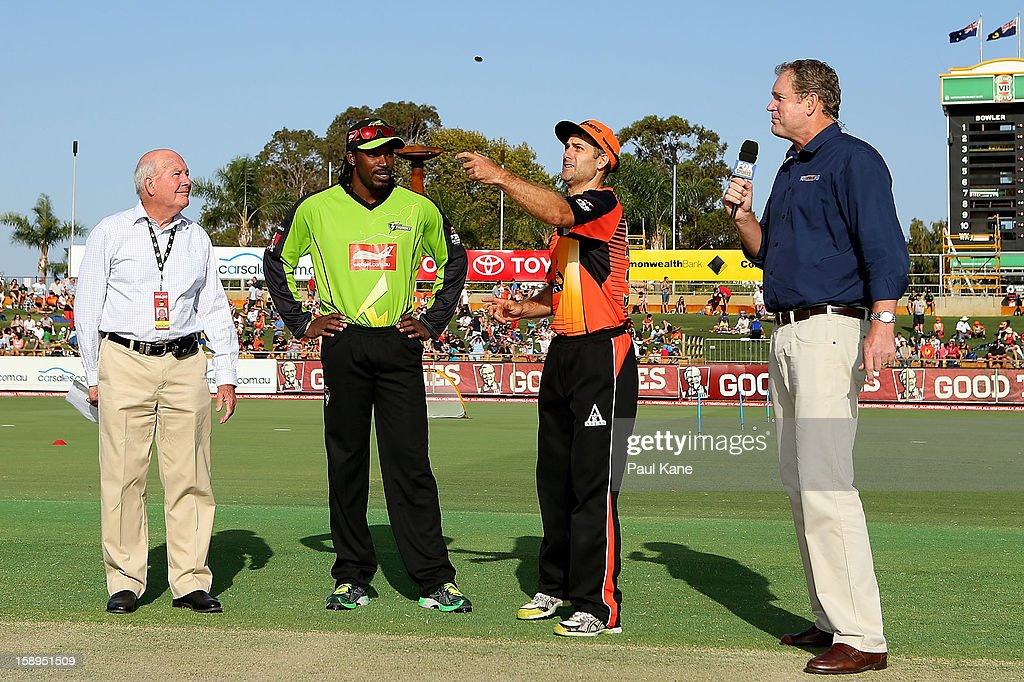 Team captains Chris Gayle of the Thunder and Simon Katich of the Scorchers take part in the coin toss during the Big Bash League match between the Perth Scorchers and the Sydney Thunder at WACA on January 4, 2013 in Perth, Australia.