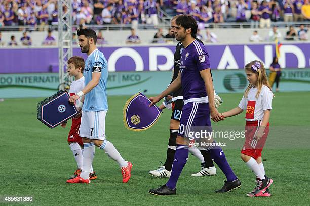 Team captains David Villa of New York City FC and Kaka of Orlando City SC leads their respective teams out during introductions prior to an MLS...