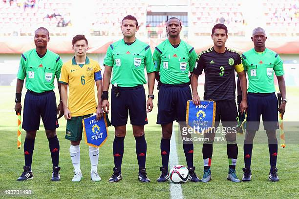 Team captains Joe Caletti of Australia and Jose Esquivel of Mexico pose with the match officials proi pose for a team photo prior to the FIFA U17...
