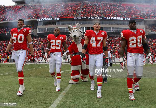 Team captains of the Kansas City Chiefs take the field for the coin toss before a game against the Tennessee Titans at Arrowhead Stadium on December...
