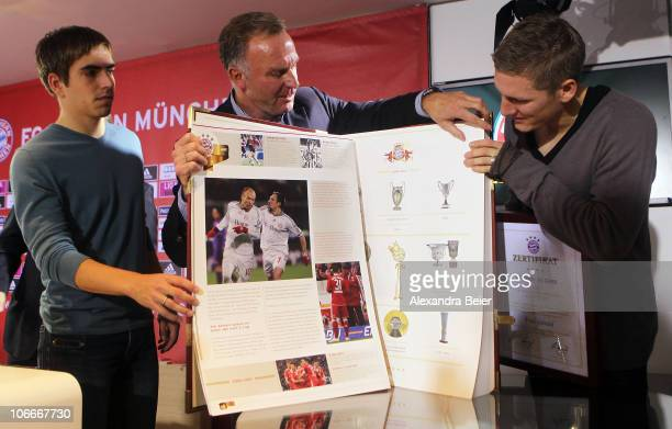 Team captains Philipp Lahm and Bastian Schweinsteiger and the CEO of Bayern Muenchen KarlHeinz Rummenigge of Bayern Muenchen present the club's...