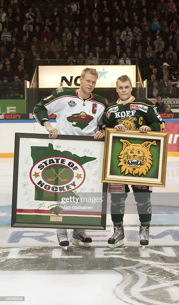 Team captains present each other with a plaque of their respective logos at the Hakametsa icehall during the 2010 Compuware NHL Premiere game on October 4, 2010 in Tampere , Finland.