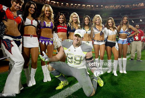Team Carter defensive end JJ Watt of the Houston Texans poses with cheerleaders after the 2015 Pro Bowl at University of Phoenix Stadium on January...