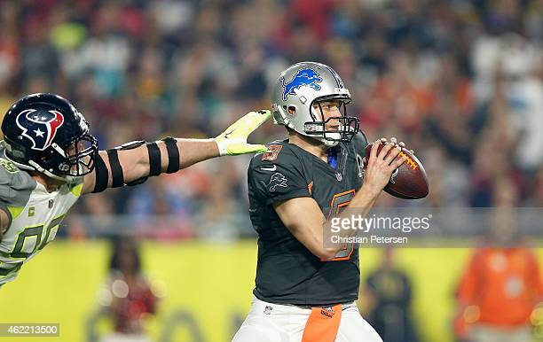 Team Carter defensive end JJ Watt of the Houston Texans tries to sack Team Irvin quarterback Matthew Stafford of the Detroit Lions during the second...