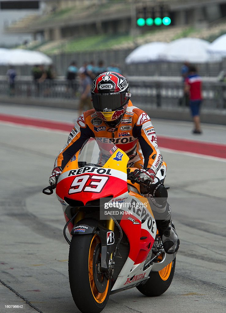 Team Catalunya Caixa Repsol's rider Marc Marquez of Spain returns back to the pit-lane on the second day of the pre-season MotoGP test at the Sepang circuit in Sepang outside Kuala Lumpur on February 6, 2013. AFP PHOTO / Saeed Khan