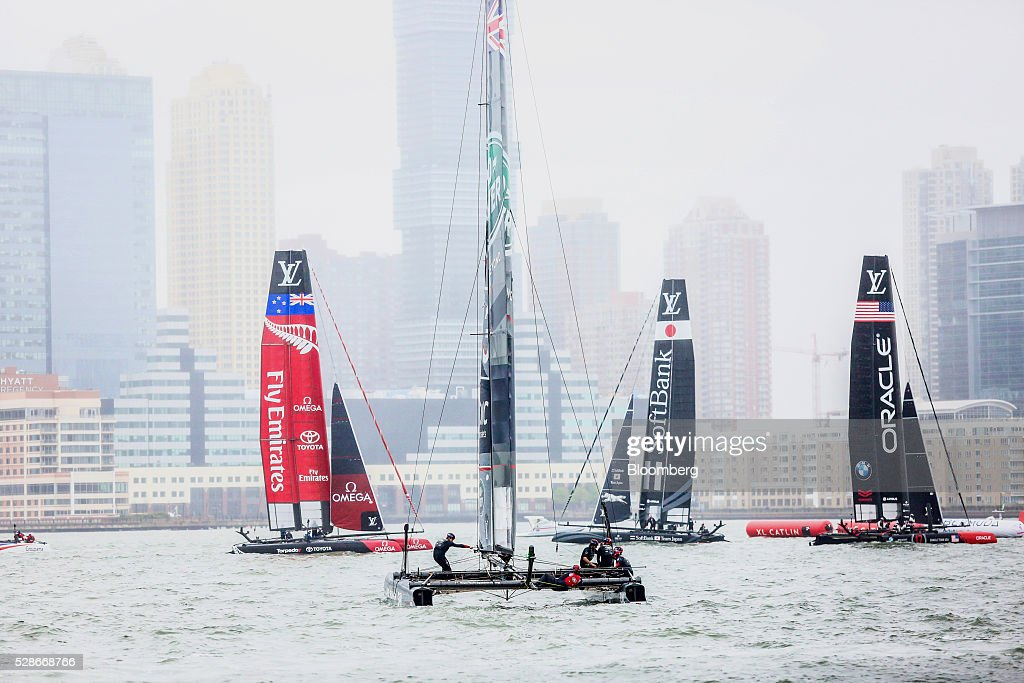 Team catamarans sail during practice ahead of the Louis Vuitton America's Cup World Series races in New York, U.S., on Friday, May 6, 2016. The America's Cup sailing races are held in New York City on the Hudson River for the first time since 1920. Photographer: Chris Goodney/Bloomberg via Getty Images