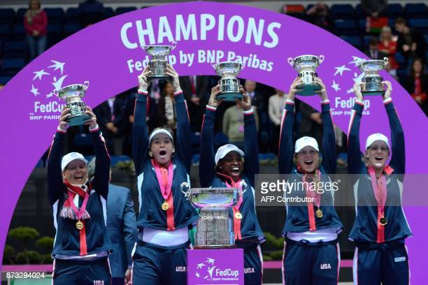 US team celebrate with their trophy after winning the Fed Cup final tennis match between Belarus and the United States on November 12 2017 in Minsk /...