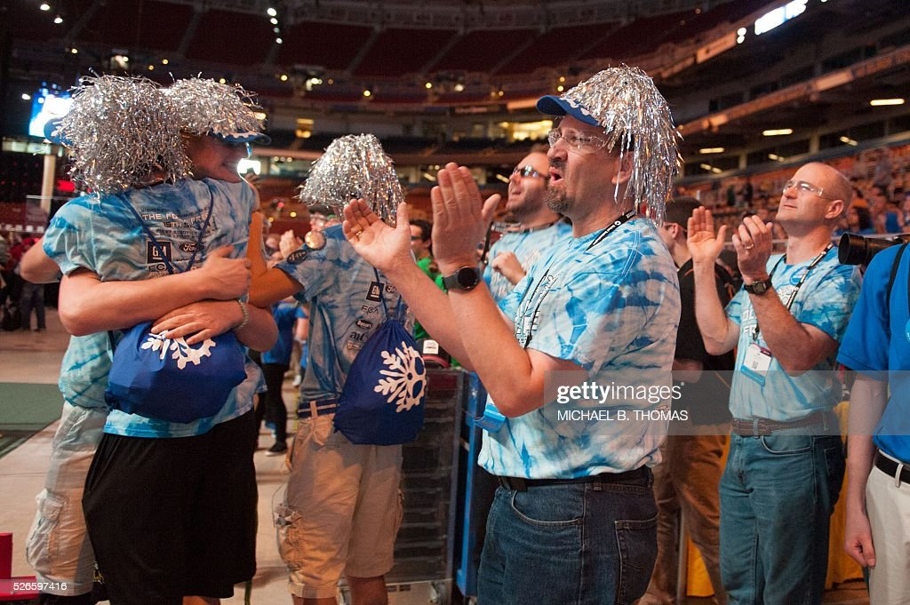 A team celebrates victory during the FIRST Robotics Championships on April 30, 2016 in St. Louis, Missouri. Six hundred teams representing 10 countries compete over three days. / AFP / Michael B. Thomas