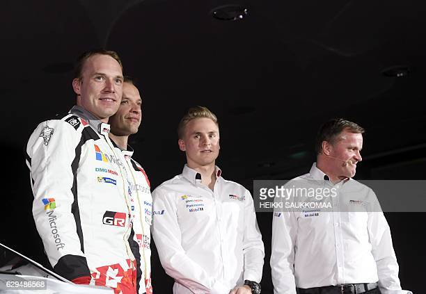 Team chief former Rally World Champion Tommi Makinen poses with his next season's drivers JariMatti Latvala Juho Hanninen and Esapekka Lappi during...