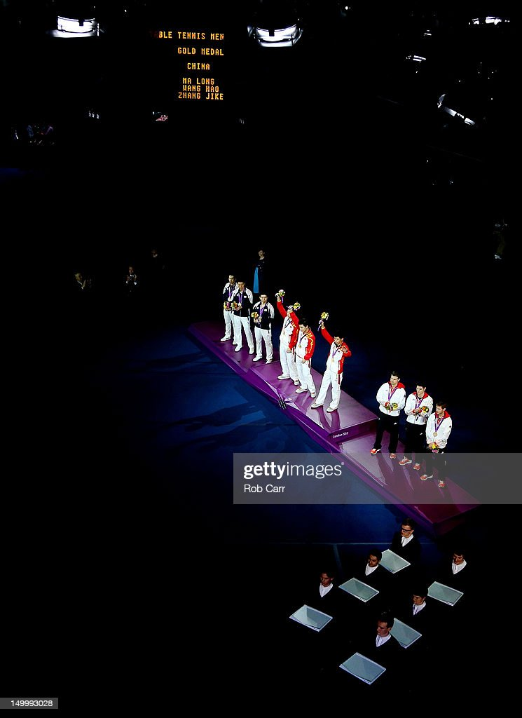 Team China (C) celebrate with their gold medals, team Korea (L) with their silver medals and team Germany (R) with their bronze medals on the podium during the medal ceremony for the Men's Team Table Tennis on Day 12 of the London 2012 Olympic Games at ExCeL on August 8, 2012 in London, England.