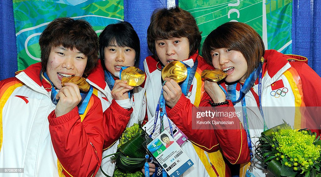 Team China celebrates receiving the gold medal during the medal ceremony for the ladies' 3000 m relay short track on day 14 of the Vancouver 2010 Winter Olympics at BC Place on February 25, 2010 in Vancouver, Canada. While celebrating their win last night, <a gi-track='captionPersonalityLinkClicked' href=/galleries/search?phrase=Wang+Meng&family=editorial&specificpeople=774285 ng-click='$event.stopPropagation()'>Wang Meng</a> of Team China accidentally cut the face of teammate <a gi-track='captionPersonalityLinkClicked' href=/galleries/search?phrase=Zhang+Hui&family=editorial&specificpeople=2720737 ng-click='$event.stopPropagation()'>Zhang Hui</a> (2L) with the blade of her ice skate.
