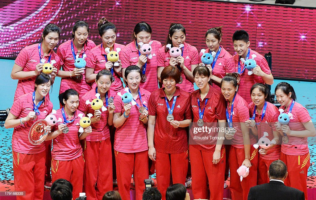 Team China players and support staff pose for photographes on the podium after winning the silver medal during awards ceremony for the FIVB World Grand Prix Sapporo 2013 at Hokkaido Prefectural Sports Center on September 1, 2013 in Sapporo, Hokkaido, Japan.