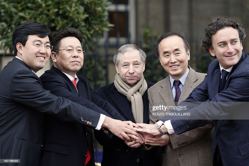 Team China Racing CEO Steven Lu, Team China Racing Chairman Yu liu, President of the Federation International Automobile Jean Todt, Chinese Embassy's First secretary Liang Jian Sheng, and Formula E Holdings (FEH) CEO, Alejandro Agag pose after at press conference to present the second team of the electric car Formula E motor racing competition on February 27, 2013 in Paris. Promoters of the fledgling electric car Formula E unveiled China Racing as the second team to sign up for next year's inaugural world championship. The Chinese outfit joins British team Drayson Racing for the new format starting in 2014 that will feature cars powered solely by electricity. AFP PHOTO KENZO TRIBOUILLARD