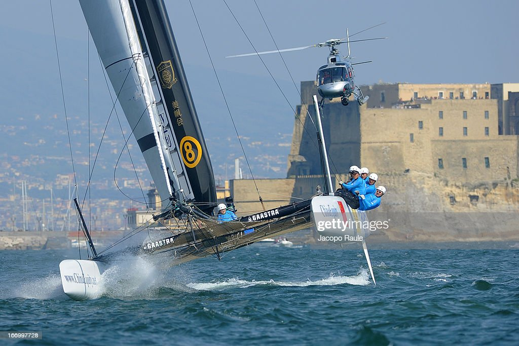 Team China skippered by Mitch Booth of the Netherlands competes in front of Castel Dell'Ovo in Quarter Finals during America's Cup World Series Naples on April 19, 2013 in Naples, Italy.