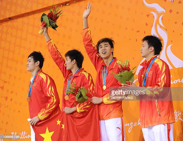 Team China Zhang Lin Jiang Haiqi Li Yun Qi and Sun Yang celebrate on the podium during the award ceremony for the men's 4x200m freestyle relay in the...