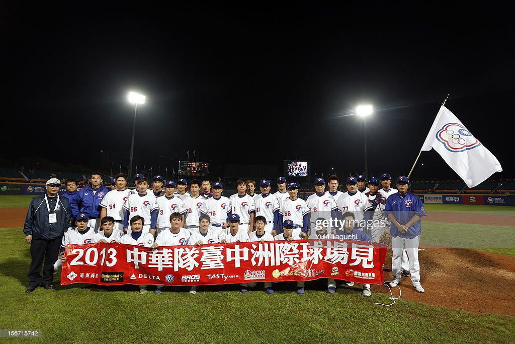 Team Chinese Taipei poses for a team photo after defeating Team New Zealand in Game 6 to win the 2013 World Baseball Classic Qualifier at Xinzhuang Stadium in New Taipei City, Taiwan on Sunday, November 18, 2012.