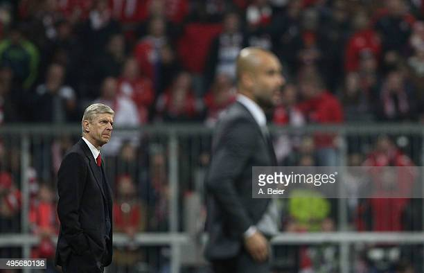 Team coach Arsene Wenger of Arsenal FC and team coach Josep Guardiola of Bayern Muenchen are pictured during the UEFA Champions League Group F match...