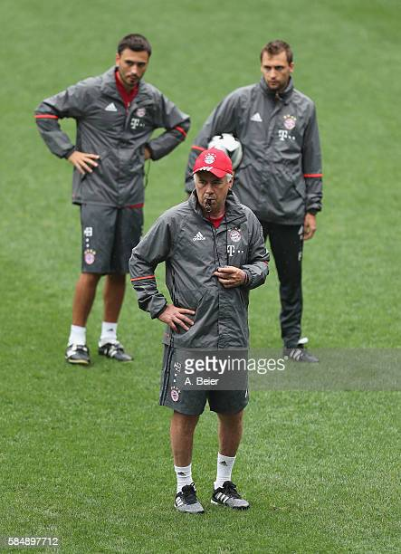 Team coach Carlo Ancelotti of FC Bayern Muenchen is pictured next to his assistent coaches Davide Ancelotti and Francesco Mauri during a training...