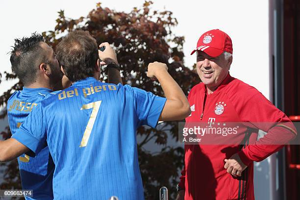 Team coach Carlo Ancelotti of FC Bayern Muenchen jokes with comedians Pio and Amedeo of the Italian TV program Emigratis before a training session at...