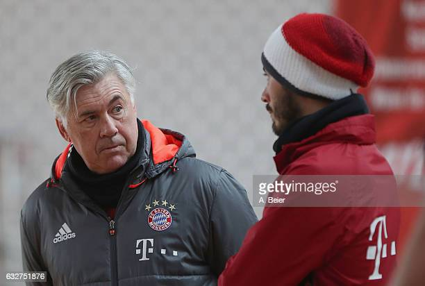 Team coach Carlo Ancelotti of FC Bayern Muenchen talks to his assistent coach and son Davide Ancelotti during a training session at the Saebener...