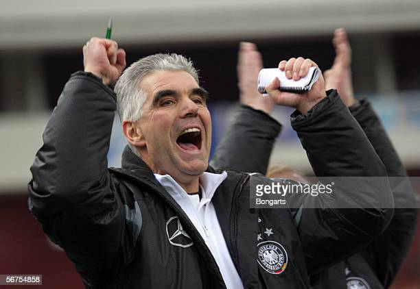 Team coach Frank Engel of Germany celebrates after the team won the men's Under 18 match between Germany and Russia at the International St...