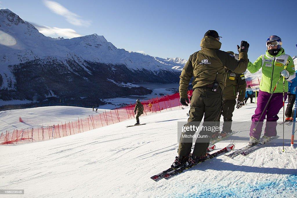 US Team coach Jeff Fergus and Roland Pfeifer briefs Lindsey Vonn before the Audi FIS Alpine Ski World Giant Slalom race on December 9 2012 in St Moritz, Switzerland.
