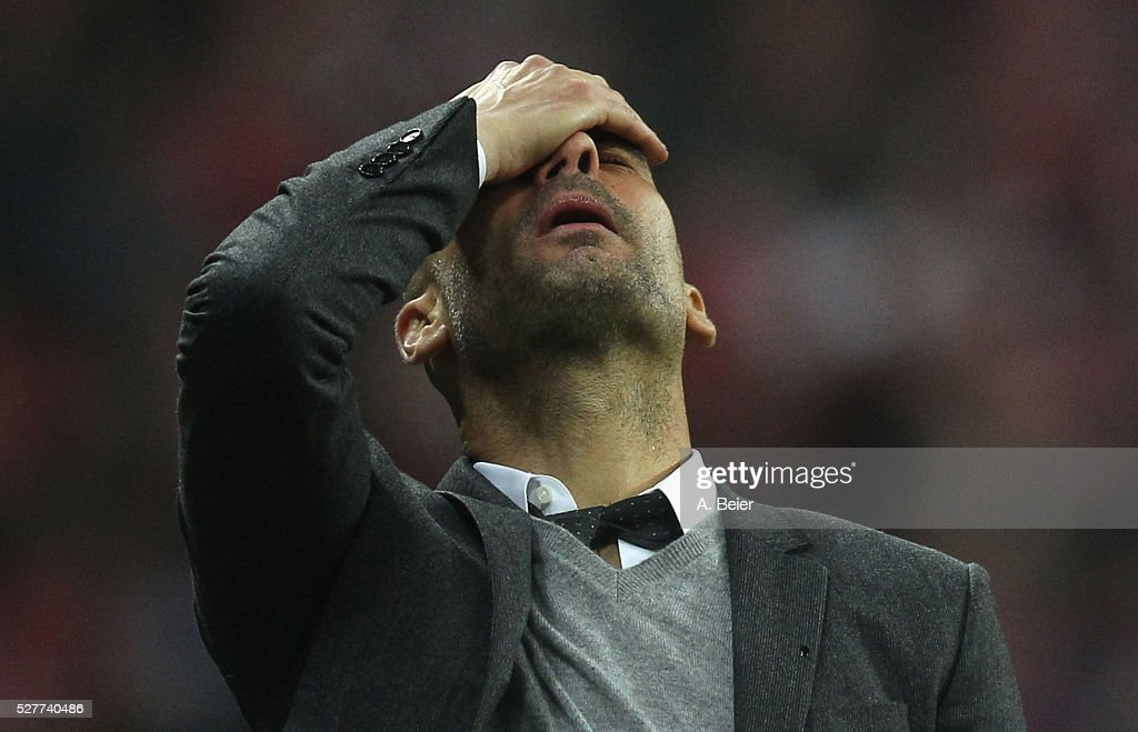 Team coach Josep Guardiola of Bayern Muenchen reacts during the Champions League semi final second leg match between FC Bayern Muenchen and Club Atletico de Madrid at Allianz Arena on May 3, 2016 in Munich, Germany.