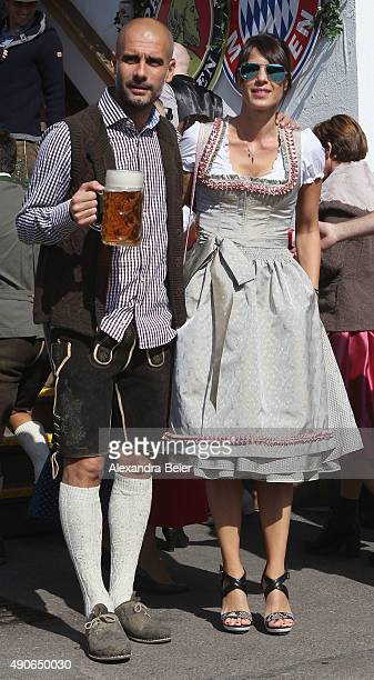 Team coach Josep Guardiola of FC Bayern Muenchen and his wife Cristina attend the Oktoberfest beer festival 2015 at Theresienwiese on September 30...