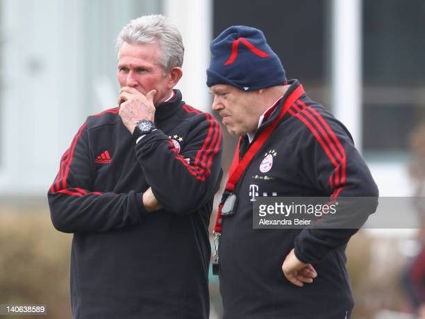 Team coach Jupp Heynckes and assistent coach Hermann Gerland of Bayern Muenchen chat during a training session on March 4 2012 in Munich Germany