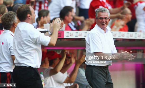 Team coach Jupp Heynckes and manager Christian Nerlinger of Bayern Muenchen celebrate their team's fifth goal during the Bundesliga match between FC...