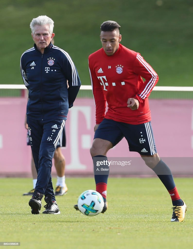 Team coach Jupp Heynckes (L) of FC Bayern Muenchen looks at Corentin Tolisso during a training session at the Saebener Strasse training ground on October 12, 2017 in Munich, Germany.