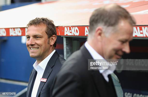 Team coach Markus Weinzierl and sporting director Stefan Reuter of Augsburg smile before the Bundesliga match between FC Augsburg and Hamburger SV at...