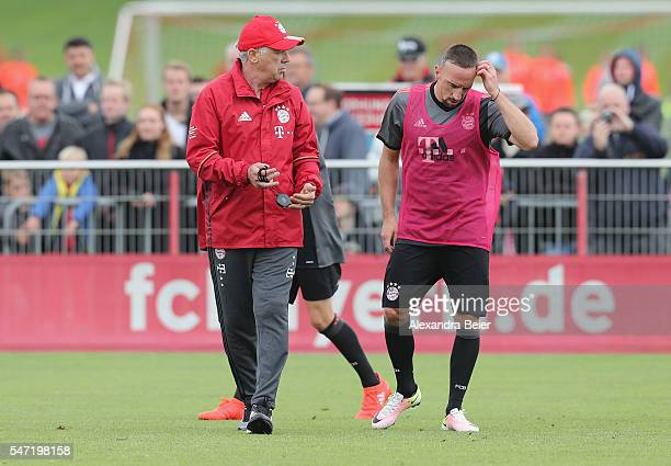 Team coach of FC Bayern Muenchen Carlo Ancelotti talks to Franck Ribery during a training session at Saebener Strasse training ground on July 14 2016...
