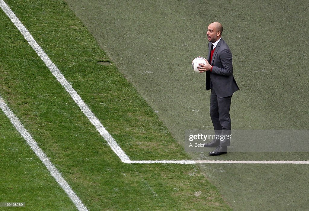 Team coach Pep Guardiola of Bayern Muenchen reacts during the Bundesliga match between FC Bayern Muenchen and SC Freiburg at Allianz Arena on February 15, 2014 in Munich, Germany.