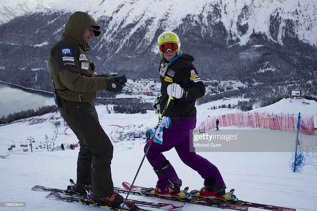 US Team coach Roland Pfeifer briefs Julia Ford before the Audi FIS Alpine Ski World Giant Slalom race on December 9 2012 in St Moritz, Switzerland.