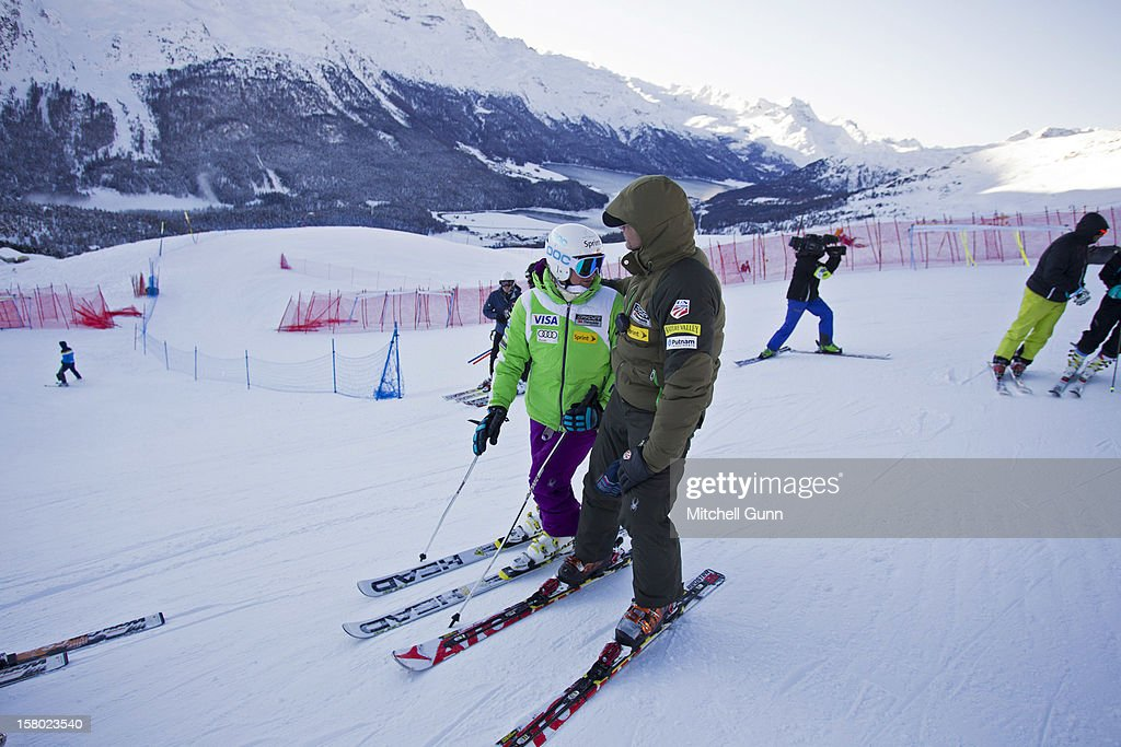 US Team coach Roland Pfeifer briefs Julia Mancuso of USA before the Audi FIS Alpine Ski World Giant Slalom race on December 9 2012 in St Moritz, Switzerland.