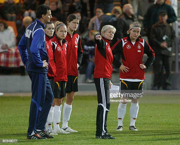 Team coach Silvia Neid of the women's German national football team talks to Saskia Bartusiak goalkeeper coach Michael Fuchs Simone Laudehr Babett...