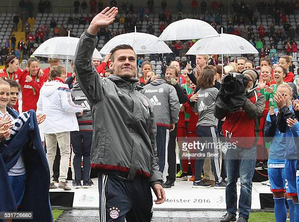 Team coach Thomas Woerle of Bayern Muenchen waves to the fans after his team's victory of the German Championship title after the women Bundesliga...