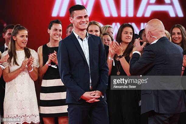 Team coach Thomas Woerle of the FC Bayern Muenchen women team is interviewed by speaker Stefan Lehmann during the Bundesliga Champions Dinner at the...