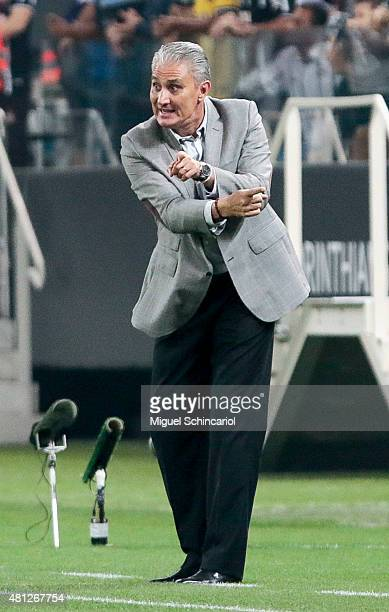 Team coach Tite of Corinthians gestures during a match between Corinthians v Atletico MG of Brasileirao Series A 2015 at Arena Corinthians on July 18...