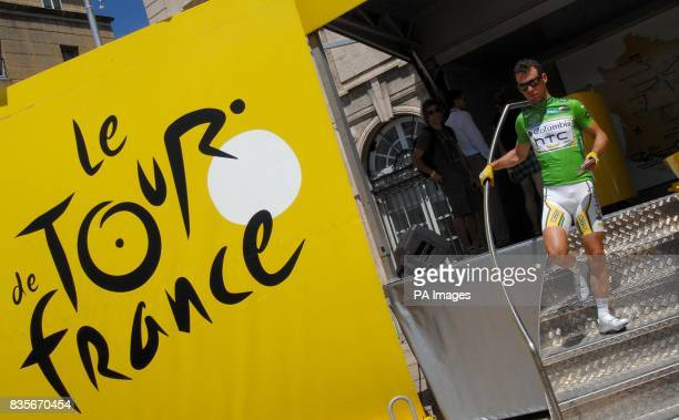 Team Columbia's Mark Cavendish signs in before the start of the third stage of the Tour de France between Marseille and La GrandeMotte